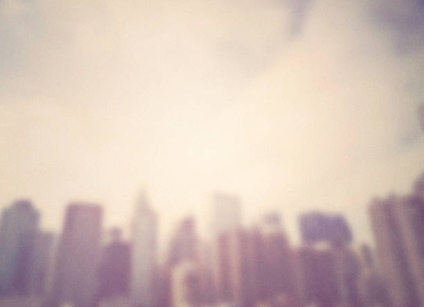 cityscape backgrounds. blurred cityscape with texture and grain. ny city. - soft focus stock photos and pictures