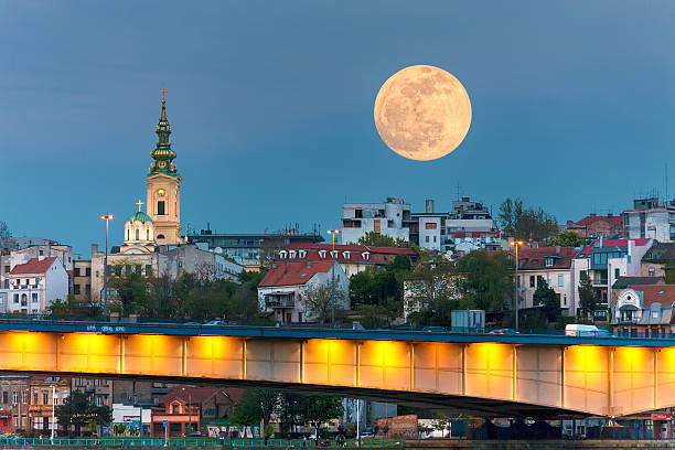 cityscape - belgrade in night of full moon - belgrade serbia stock photos and pictures