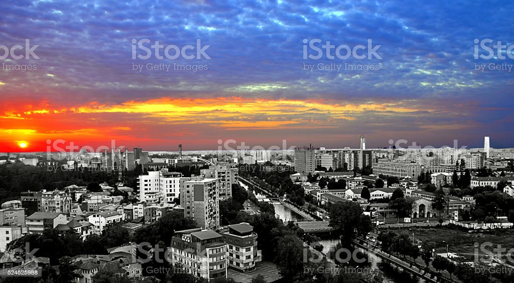 Cityscape Capital Bucharest at sunset colorful stock photo