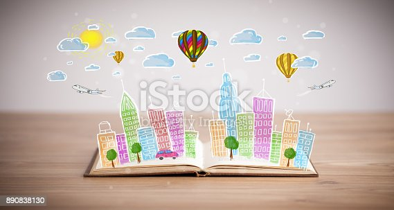 istock cityscape drawing on open book 890838130