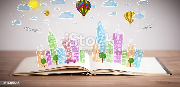 istock cityscape drawing on open book 934095648