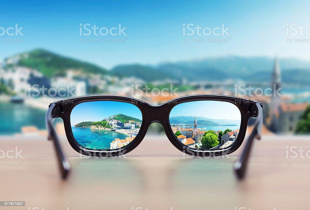 Cityscape focused in glasses lenses stock photo