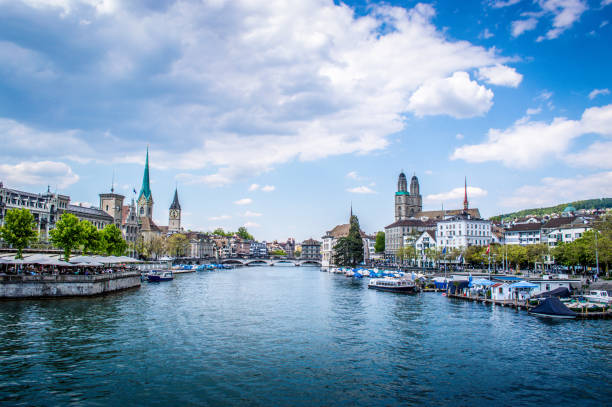 Cityscape From Limmat River in Zurich, Switzerland Cityscape From Limmat River in Zurich, Switzerland fraumunster stock pictures, royalty-free photos & images