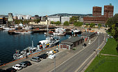 Cityscape harbour and City Hall viewed behind the port in Oslo, Norway