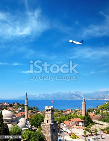 istock cityscape image of historic district of Antalya and flying airplane over Mediterranean sea and high mountains 1152623925