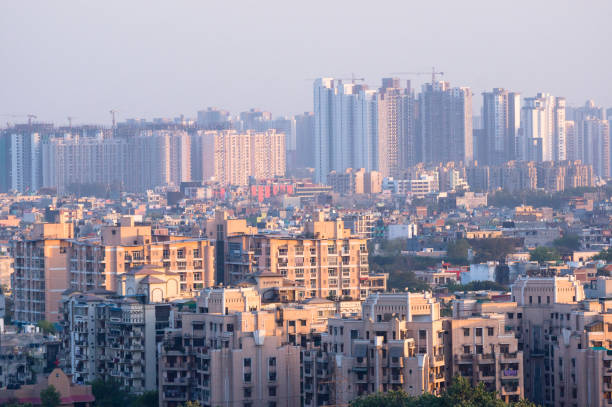 Cityscape in an indian city with concrete buildings and skyscrap Cityscape in Noida, gurgaon, jaipur, delhi, lucknow, mumbai, bangalore, hyderabad showing small houses sky scrapers and other infrastructure options bangalore stock pictures, royalty-free photos & images