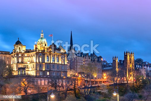 istock Cityscape in old town district of Edinburgh City being lit up at night in central Edinburgh, Scotland, UK 1004706262