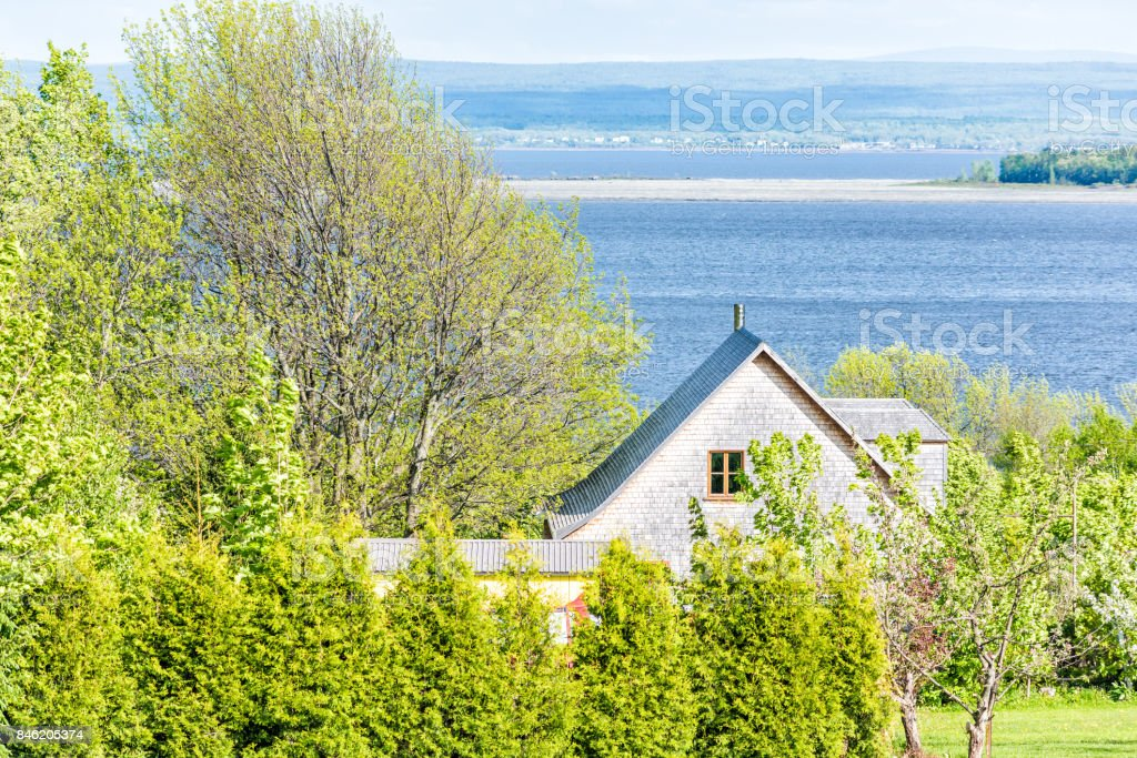 Cityscape landscape view in Ile D'Orleans, Quebec, Canada with houses, Saint Lawrence river and hills stock photo