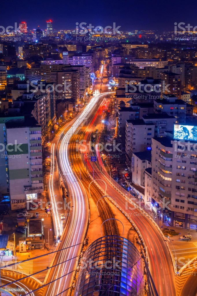 Cityscape long exposure with traffic lights and cars with modern buildings skyline stock photo
