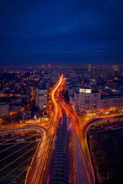 Cityscape long exposure with traffic lights and cars with modern buildings stock photo