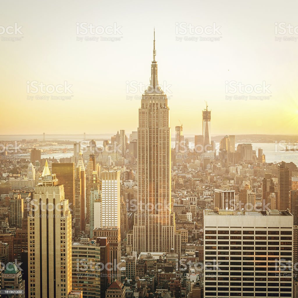 "Cityscape Manhattan Sunset New York ""New York City Skyline with Empire State Building and Downtown Manhattan in golden light during sunset. New York City, USA."" Architecture Stock Photo"