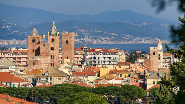 Cityscape of Albenga The medieval towers in the cityscape of the ligurian village of Albenga, situated on the italian Riviera artistical stock pictures, royalty-free photos & images