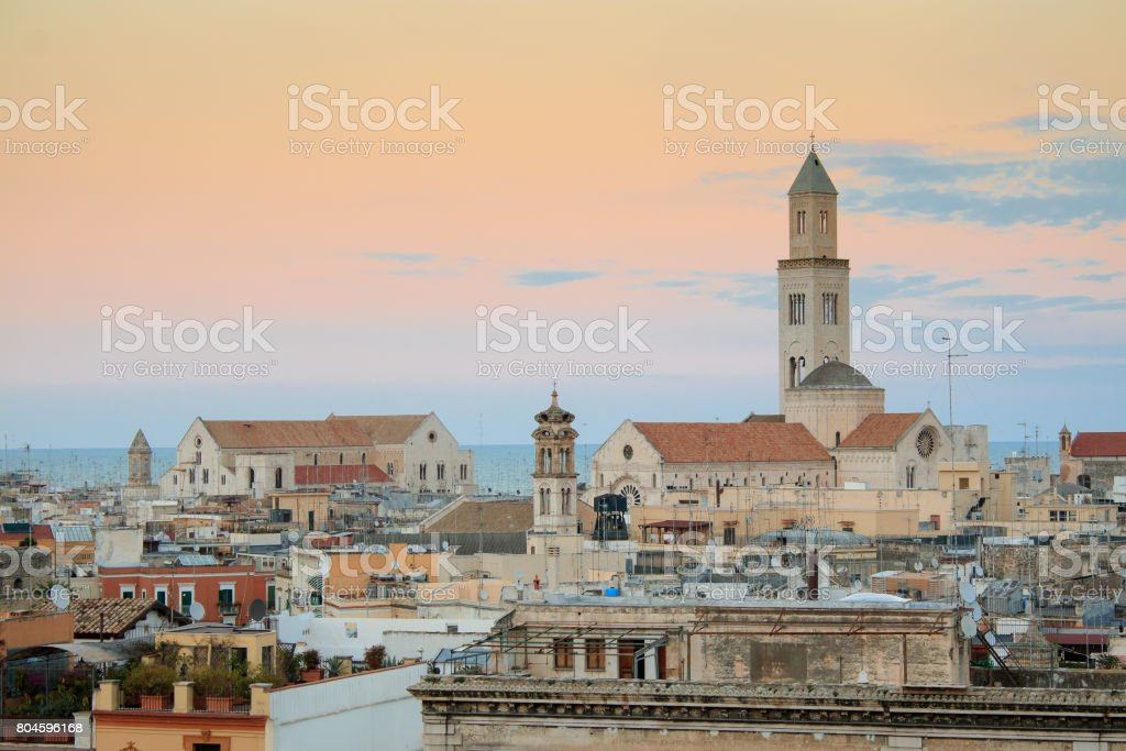 Cityscape of Bari at sunset with Basilica of San Nicola and Romanesque Cathedral stock photo