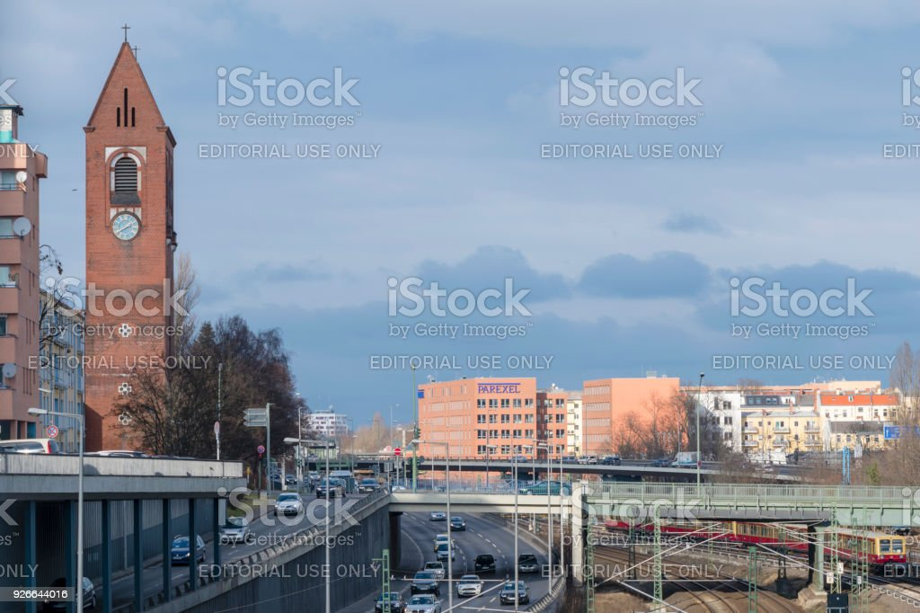 Cityscape of Berlin with church, highway and railroad lines stock photo