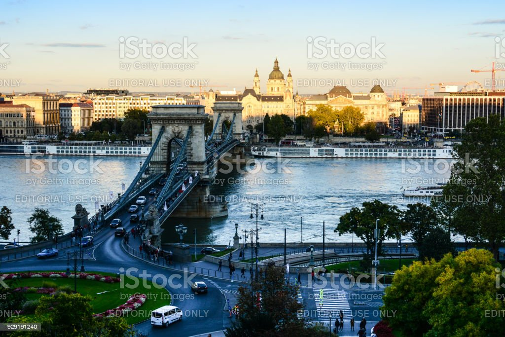 Cityscape of Budapest with St. Stephen's Basilica, Danube river, Szechenyi Chain Bridge and lot of cars moving there stock photo