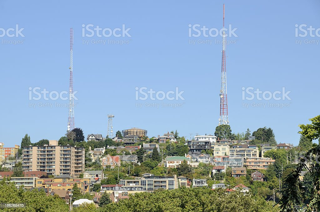 cityscape of buildings tall antennae towers stock photo