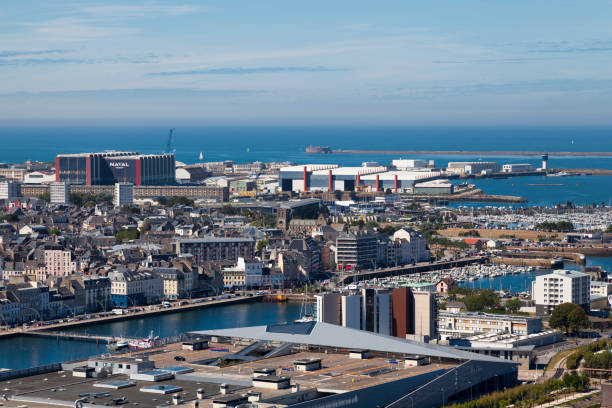 Cityscape of Cherbourg-en-Cotentin Cherbourg-en-Cotentin, France - August 06 2020: Aerial view of the city center including the shopping mall Les Eléis, the Basilica Sainte-Trinité and the West Fort. cherbourg stock pictures, royalty-free photos & images