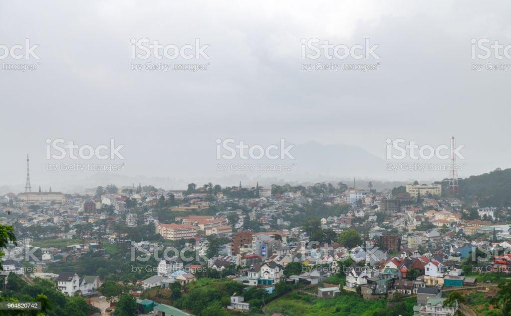 Cityscape of Da Lat, vietnam with fog in rainy royalty-free stock photo