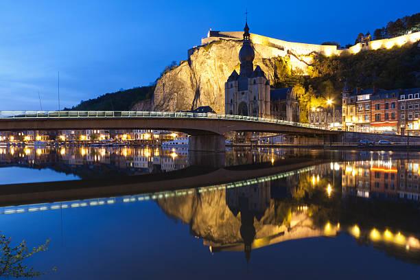 cityscape of dinant at the river meuse, belgium - maasvallei stockfoto's en -beelden