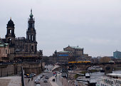 Dresden, Germany - November 14, 2009: Panoramic cityscape of Dresden with Elbe river. There is a busy street beside the Elbe river near the August Bridge.