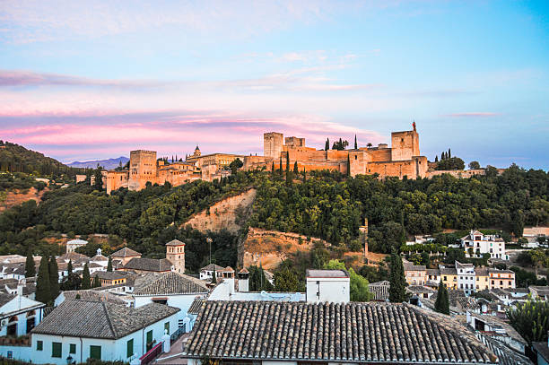 Cityscape of Granada, Spain during sunset Granada, Spain - August 13, 2015: Cityscape of Granada, Spain during sunset. Photo shot from vantage point on hill overlooking the town. palace of charles v stock pictures, royalty-free photos & images