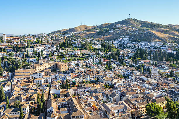 Cityscape of Granada, Spain Cityscape of Granada, Spain. Photo shot from vantage point on hill overlooking the town. palace of charles v stock pictures, royalty-free photos & images