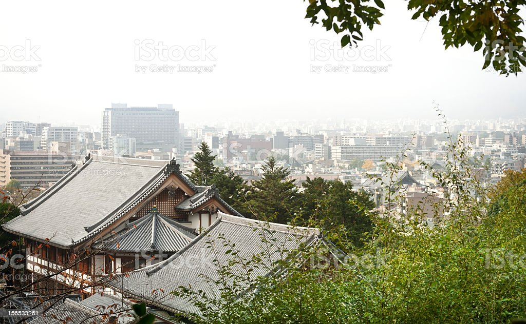 Cityscape of Kyoto with traditional temples and modern houses stock photo