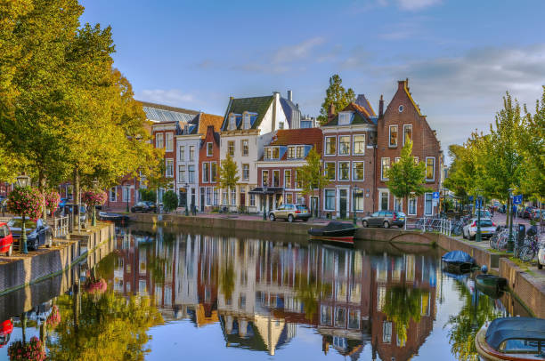 Cityscape of Leiden, Netherlands Cityscape of Leiden with channel in city center, Netherlands leiden stock pictures, royalty-free photos & images
