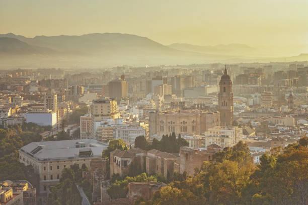 Cityscape of Malaga in sunset, Spain