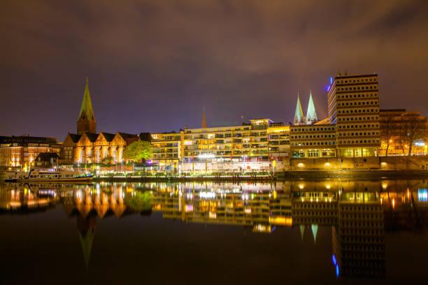 Cityscape of night Bremen, Germany over the Rhein river stock photo