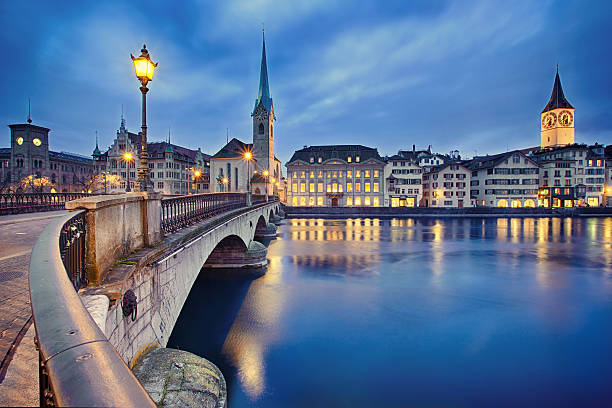 cityscape of night Zurich, Switzerland view on Fraumunster Church and Church of St. Peter at night, Zurich, Switzerland zurich stock pictures, royalty-free photos & images