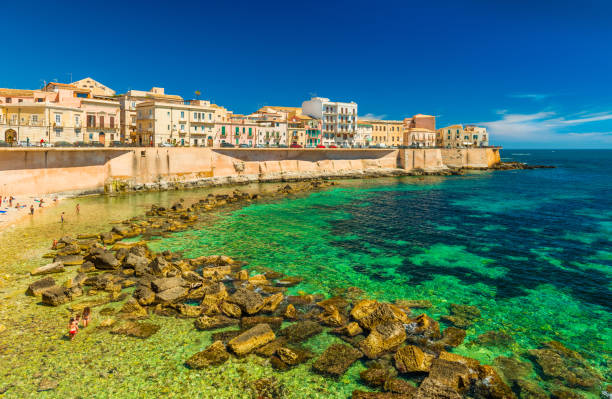 Cityscape of Ortygia. City beach in the historical center of Syracuse, famous place on Sicily, Italy stock photo