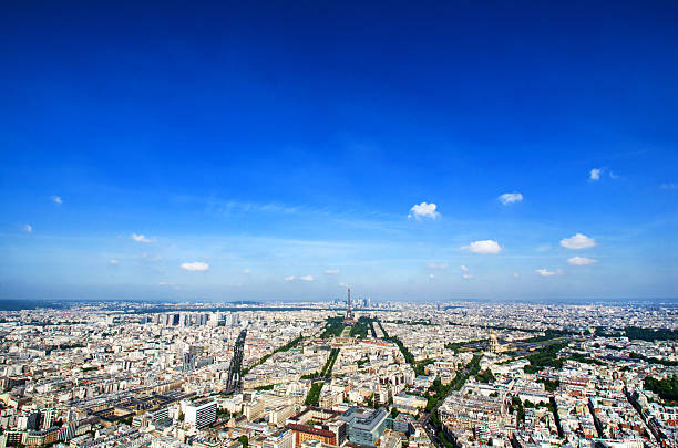 Cityscape of Paris France and The Eiffel Tower Aerial Cityscape of Paris France and The Eiffel Tower on one beautiful summer day. Fantastic clear blue sky over traditional french architecture and buildings. ile de france stock pictures, royalty-free photos & images