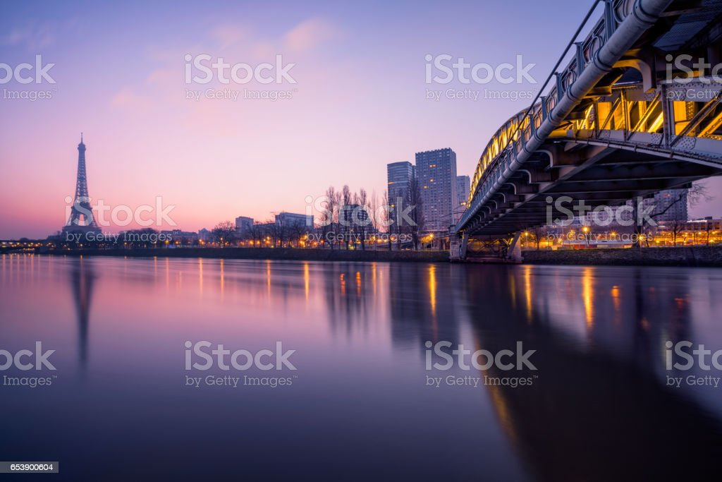 Cityscape of Paris with the Eiffel tower during the Blue hour before sunrise. The Rouelle bridge is on the right. stock photo