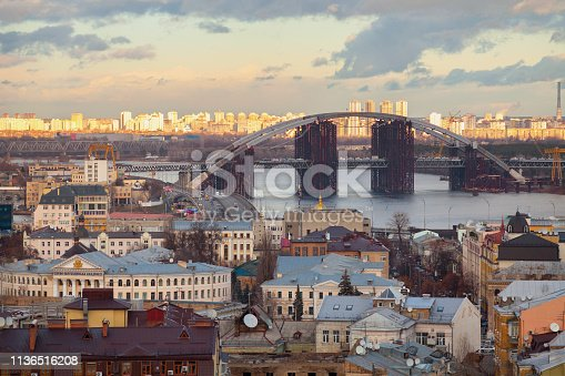 Construction of a bridge over the river. Temporary metal construct, Dnieper river, Kyiv, Ukraine