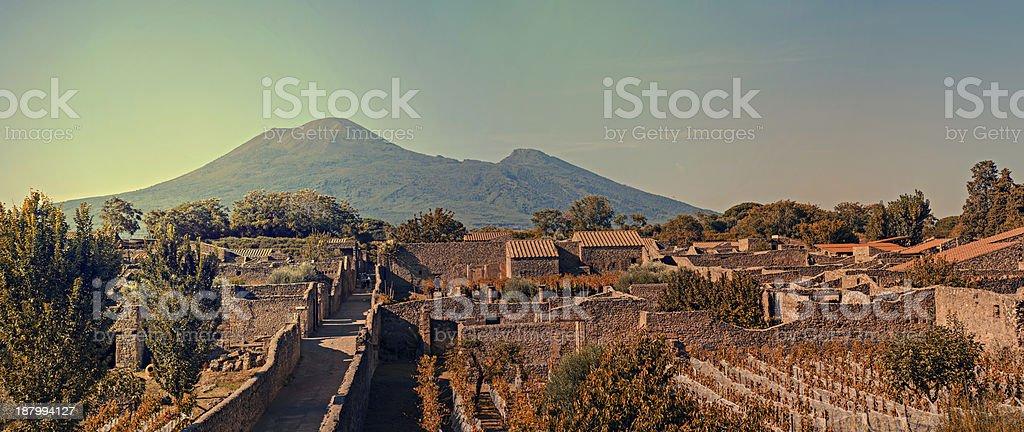 Cityscape of Pompeii with Mt Vesuvius at sunset stock photo