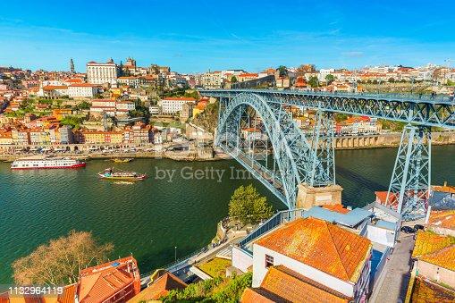 Cityscape of Porto (Oporto). View of the Dom Luis I Bridge (Ponte de Dom Luís I) and the River Douro. View from Vila Nova De Gaia, Portugal.