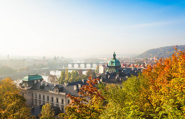 cityscape of prague in autumnal morning (prague, czech republic). - tsjechië stockfoto's en -beelden