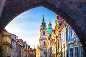 Cityscape of Prague with medieval towers and colorful buildings, Czech Republic