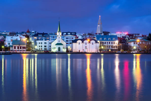 Cityscape of Reykjavik at dusk, Iceland, Europe Cityscape of Reykjavik at dusk reflected in Lake Tjörnin, Hallgrimskirkja can be seen, Iceland, Europe Hallgrímskirkja church stock pictures, royalty-free photos & images