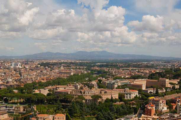 Cтоковое фото Cityscape of Rome with mountains range
