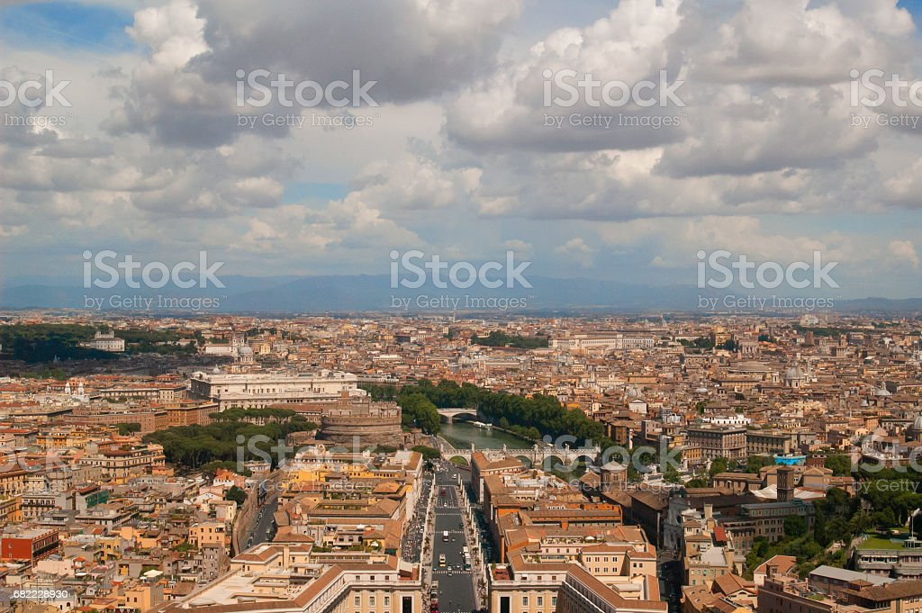 Cityscape of Rome with skyline and mountain range стоковое фото