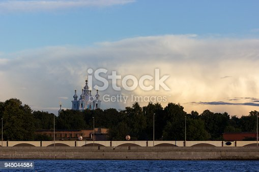 Saint-Petersburg, Russia - 16.09.2017 Summer cityscape of Smolny Cathedral in Saint-Petersburg at golden hour, view from arsenal embankment