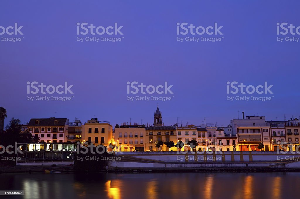 cityscape of Seville by river in dusk royalty-free stock photo