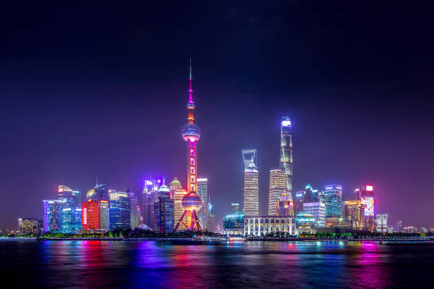 Cityscape of Shanghai at twilight sunset. Panoramic view of Pudong business district skyline from the Bund. Cityscape of Shanghai at twilight sunset. Panoramic view of Pudong business district skyline from the Bund pudong stock pictures, royalty-free photos & images