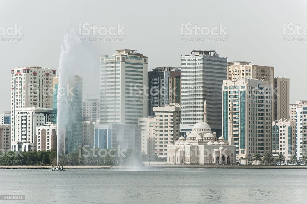 Cityscape of Sharjah with mosque and fountain, UAE stock photo