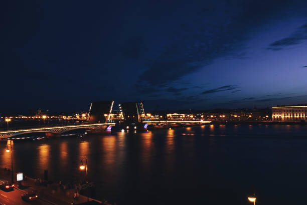 Cityscape of St Petersburg's Famous Palace Bridge Across the Neva River at Night the Structure is Rises, Opens, Lift Up, Drawing to let Ships and Boats can Pass Through bascule bridge stock pictures, royalty-free photos & images