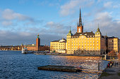 Stockholm, Sweden - December 08, 2017: Cityscape of Stockholm including the clock towers of the famous churches of Great Church (Storkyrkan) and Riddarholmen church, Stockholm, Sweden