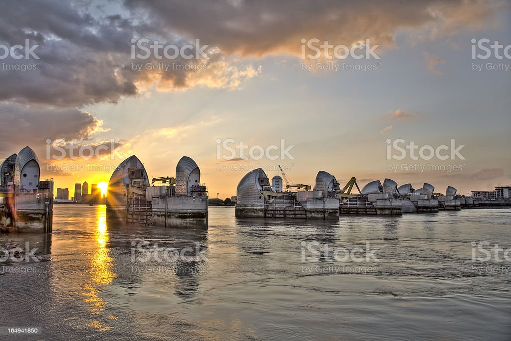 Cityscape of Thames Barrier And Canary Wharf in London stock photo