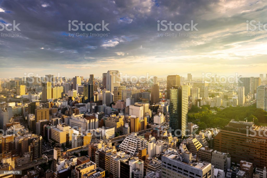 Cityscape of Tokyo, city aerial skyscraper view of office building and downtown and street of  minato in tokyo with sunset / sun rise background with yellow sunlight effect. Tokyo, Japan, Asia stock photo